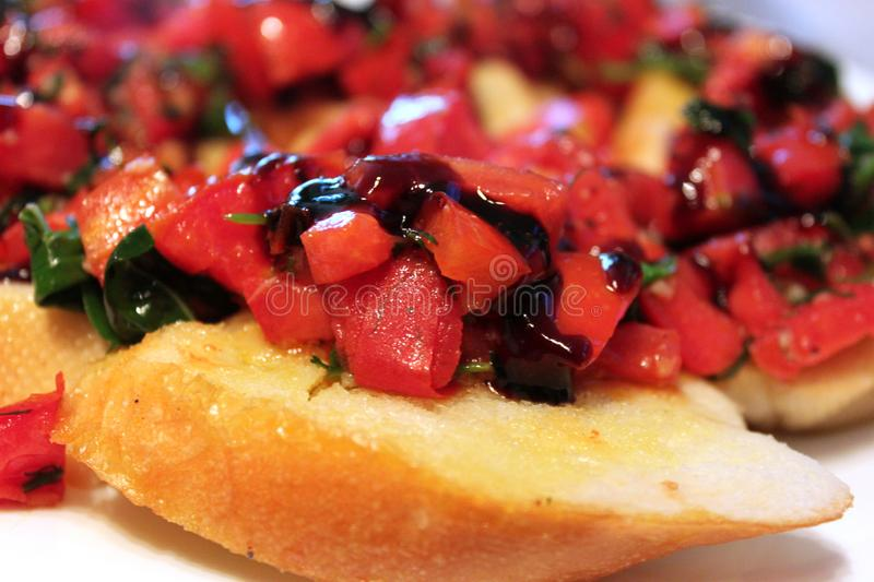 Traditional Italian sandwich Bruschetta with with tomato, olive oil, balsamic vinegar and herbs close up stock images