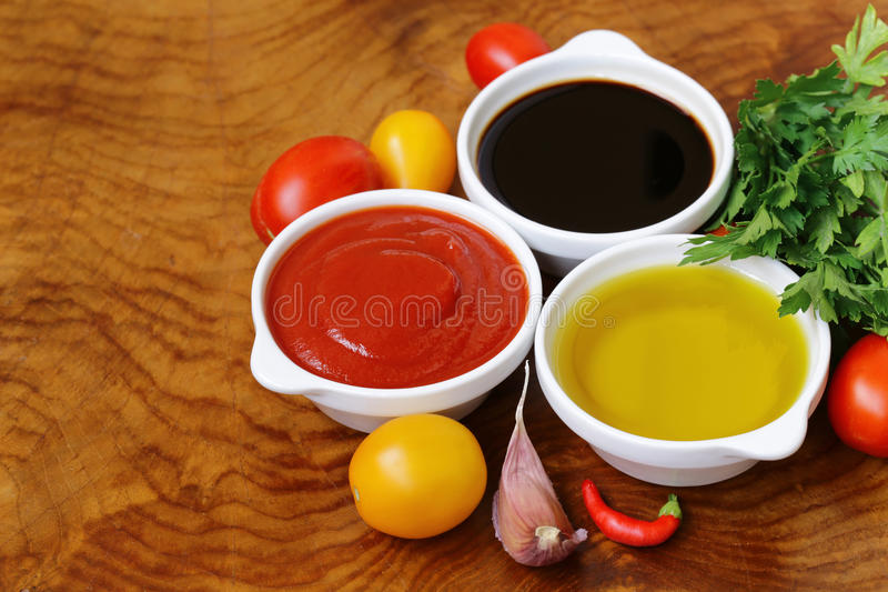 Traditional Italian sauces - balsamic, tomato sauce and olive oil royalty free stock images