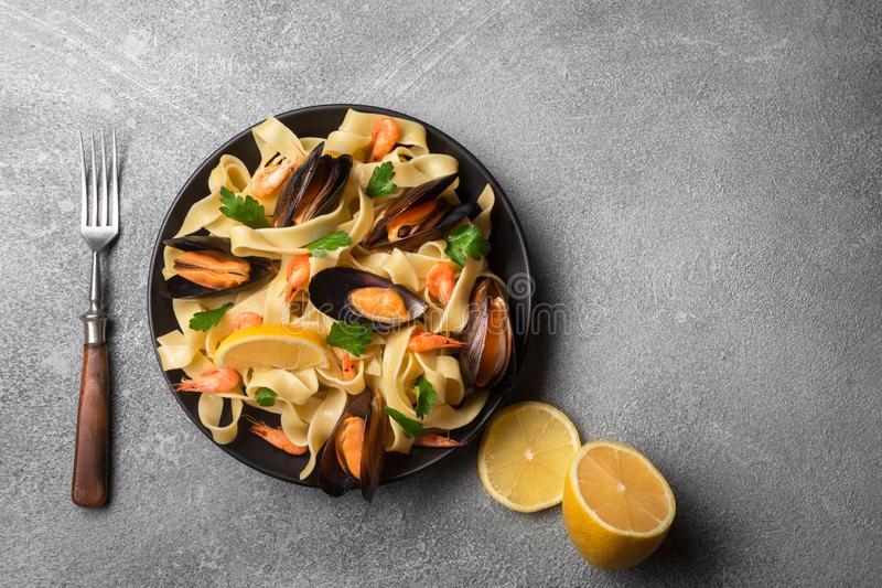 Traditional italian seafood pasta with clams Spaghetti alle Vongole on stone background royalty free stock photography