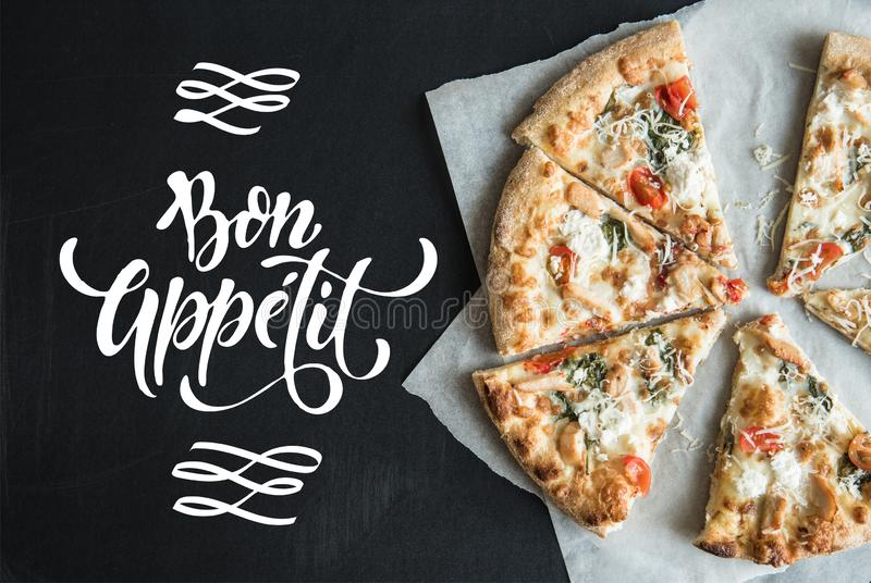 traditional italian sliced pizza on parchment stock image