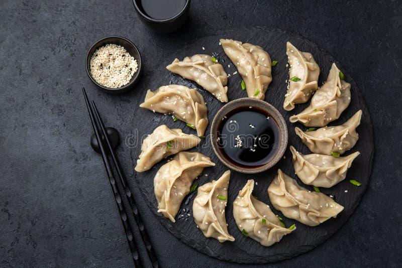 Traditional japaneese gyoza dumplings on black slate plate royalty free stock image
