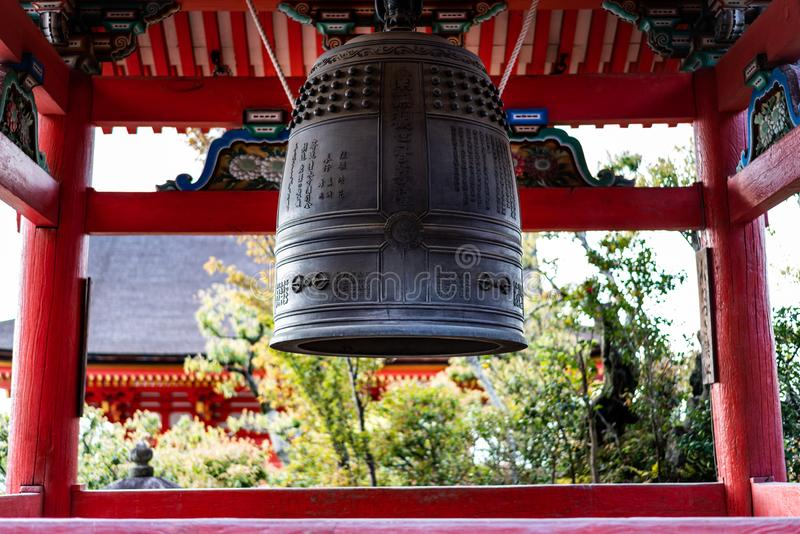 Traditional Japanese bell in a temple inscribed with Japanese wishes for prayers stock images