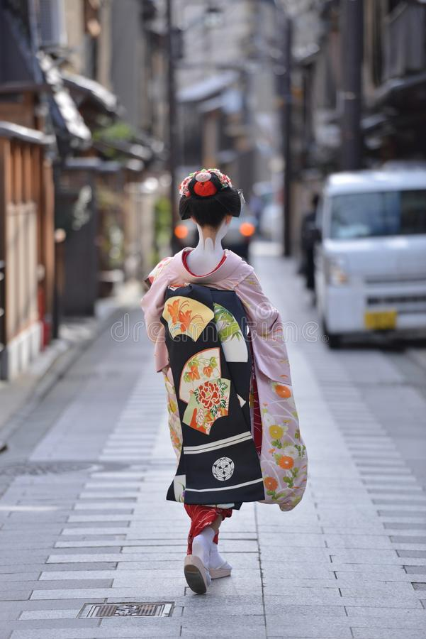 Traditional japanese costumes the kimono worn by a maika in gion corner kyoto japan. Traditional japanese costumes kimono worn by a maiko with all the make up royalty free stock photos