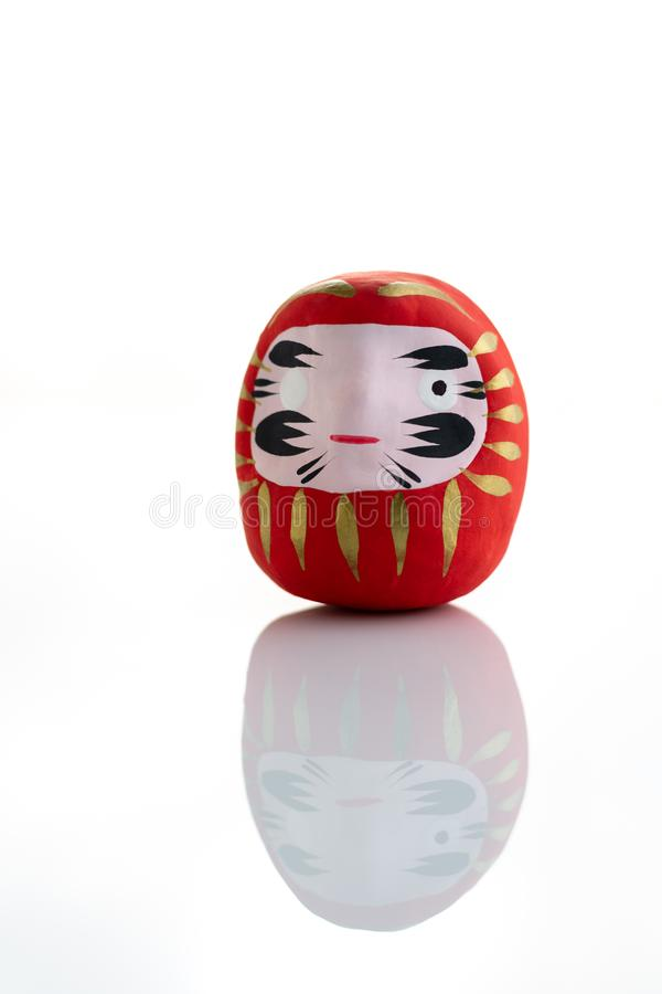 Traditional japanese Daruma doll symbol of fortune and luck isolated in white background stock photo