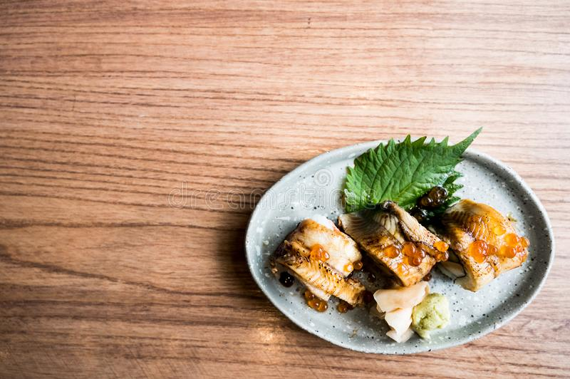 Traditional japanese eel sushi in an oval dish royalty free stock photography