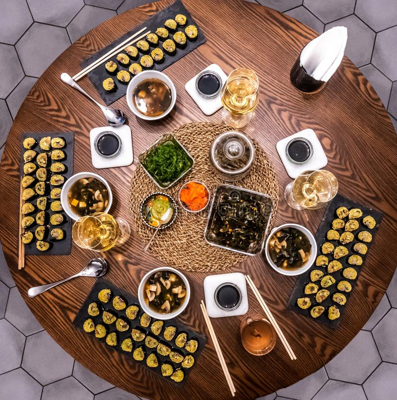 Traditional Japanese food - sushi, rolls and sauce on a wooden table. Top view royalty free stock photos