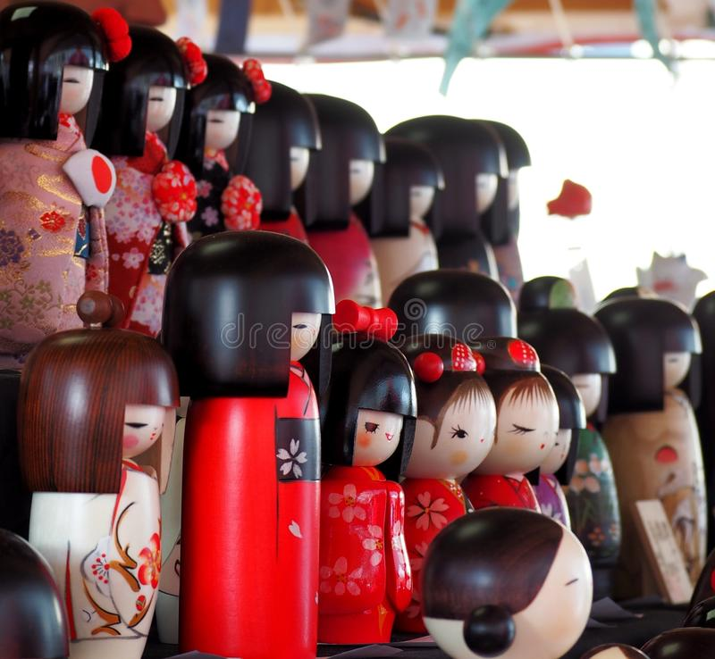 Traditional Japanese  kokeshi dolls for sale in a market stall royalty free stock image