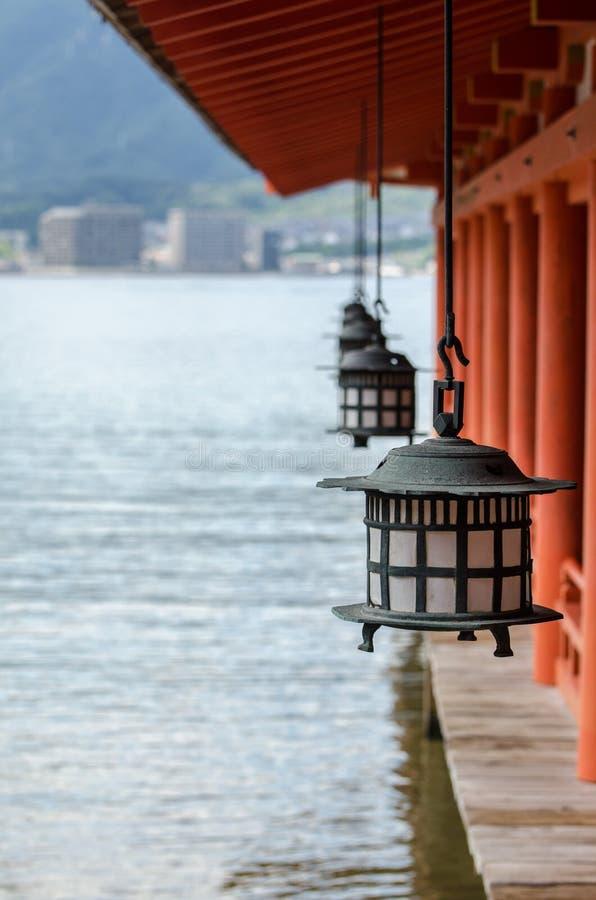 Traditional japanese lanterns in Itsukushima Shrine, Miyajima island. Japan royalty free stock image