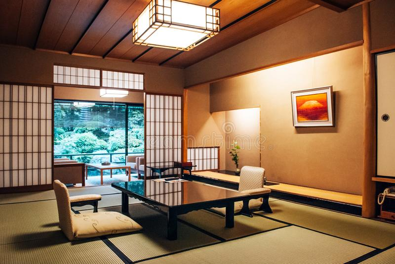 Traditional Japanese living room Tatami mat floor wood table and. MAY 25, 2013 Gifu, JAPAN - Vintage Traditional Japanese living room with sliding doors, Tatami stock images