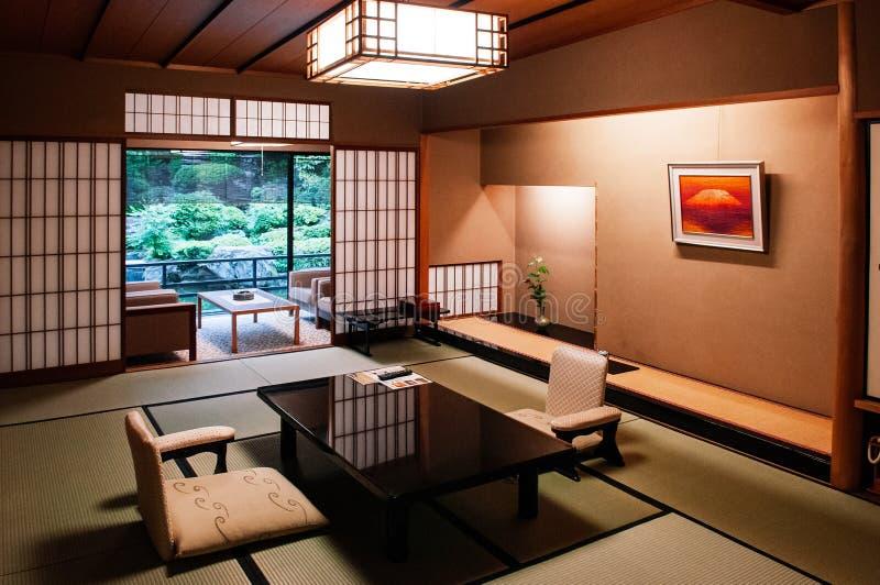 Traditional Japanese living room Tatami mat floor wood table and. MAY 25, 2013 Gifu, JAPAN - Vintage Traditional Japanese living room with sliding doors, Tatami stock photography