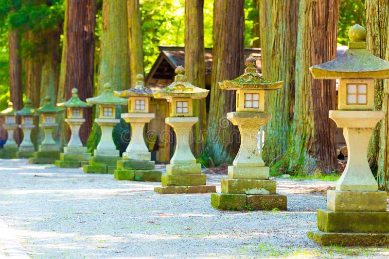 Traditional Japanese Stone Lanterns Shaded Path royalty free stock photography