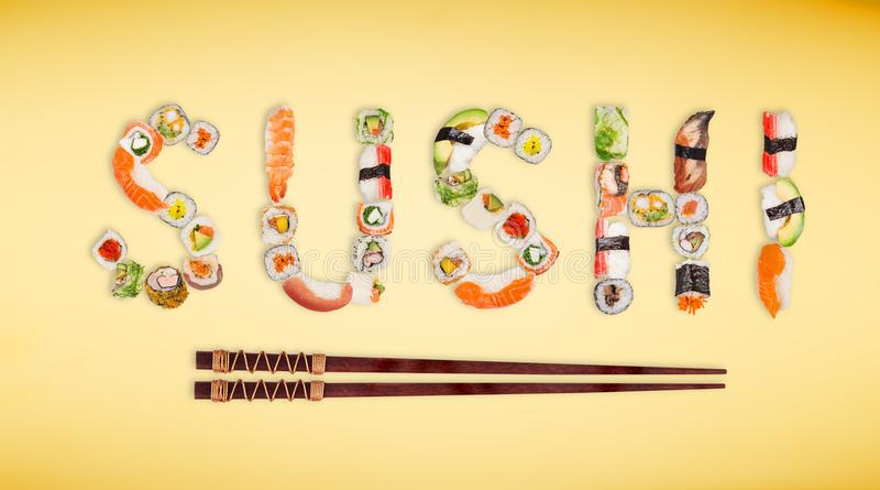 Traditional japanese sushi pieces making inscription. royalty free stock image
