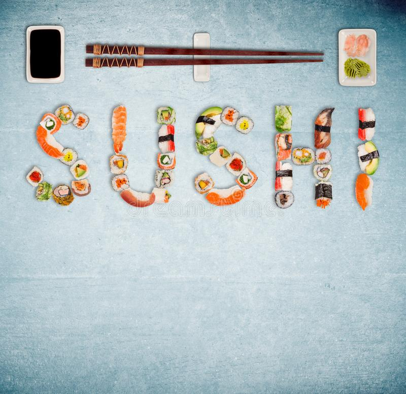 Traditional japanese sushi pieces making inscription. royalty free stock images