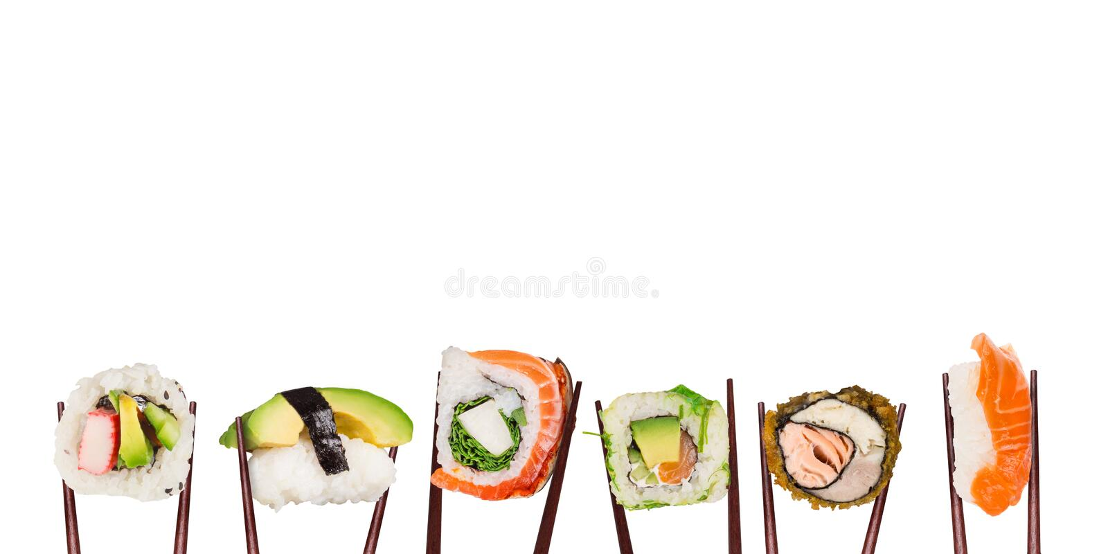 Traditional japanese sushi pieces placed between chopsticks, separated on white background. royalty free stock photography