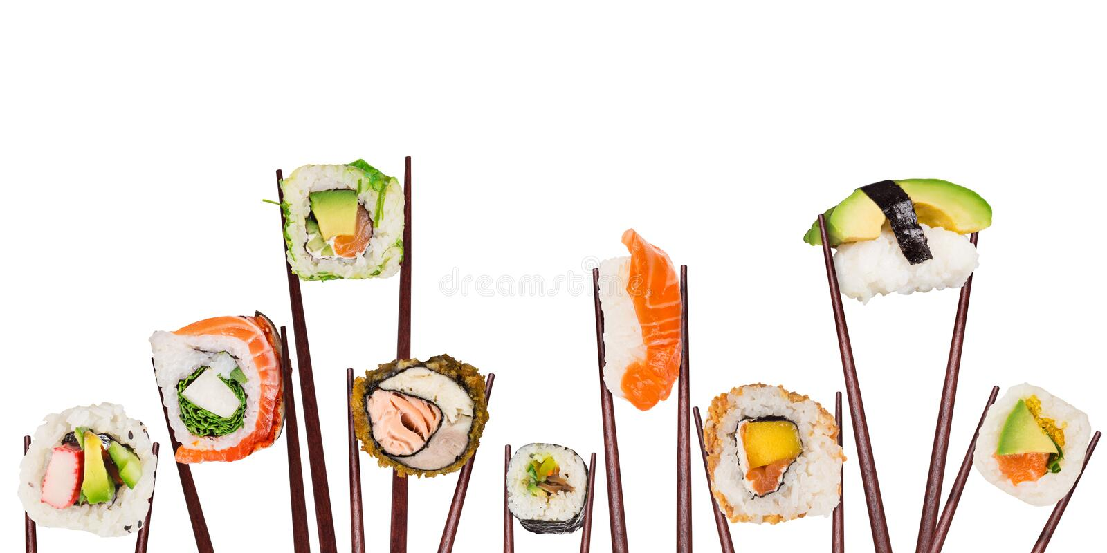 Traditional japanese sushi pieces placed between chopsticks, separated on white background. stock photo