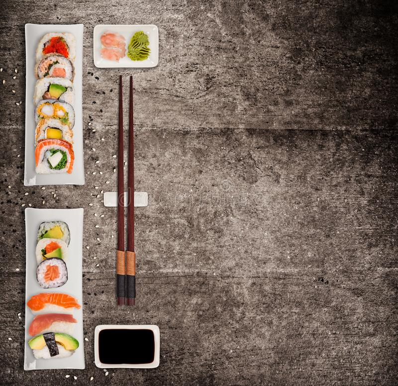 Traditional japanese sushi pieces on rustic concrete background. stock image