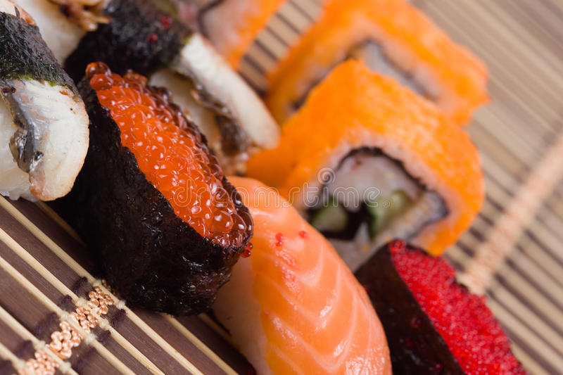Traditional japanese sushi and rolls royalty free stock photos