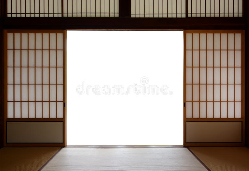 Traditional Japanese wood and rice paper doors and tatami mat flooring. Open wooden sliding doors of Japanese design and tatami mat flooring. Bright back royalty free stock photos