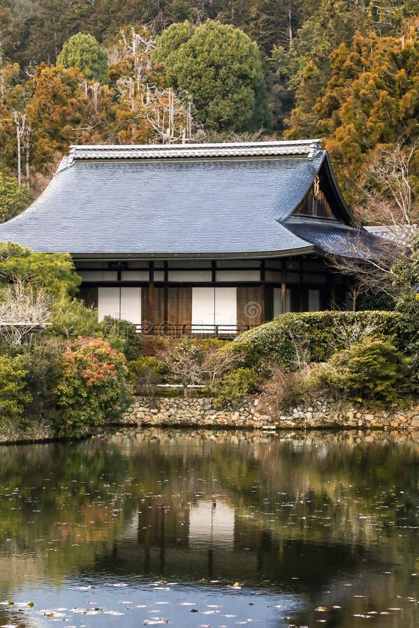 Traditional Japanese wooden architecture house surrounded by nature in autumn stock images