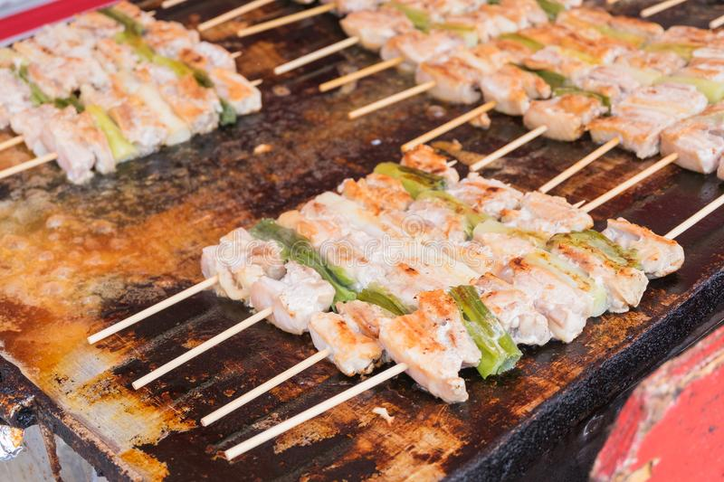Traditional japanese yakitori chicken on pan stock images