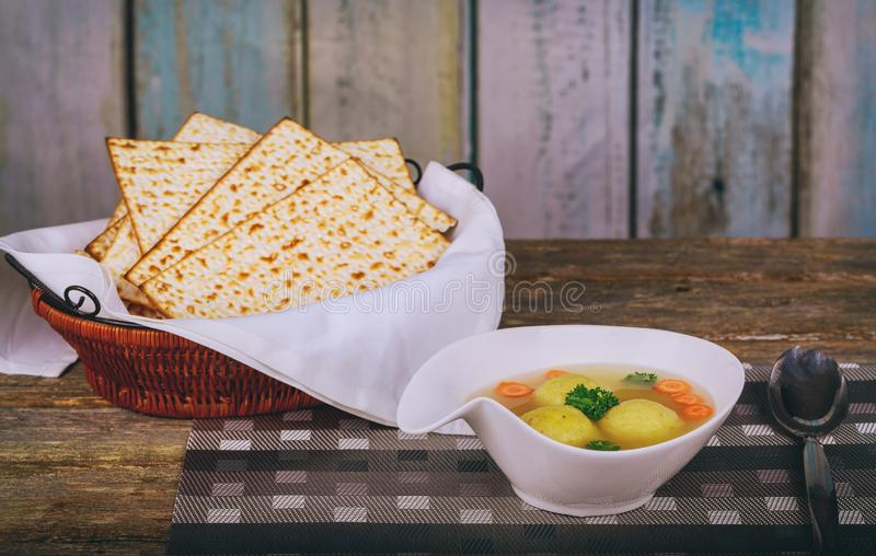 Hot Homemade Matzo Ball Soup in a Bowl Passover wine and matzah stock image