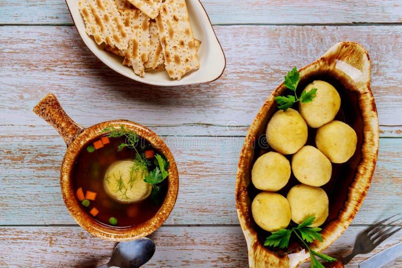 Traditional Jewish matzah ball soup with matzo balls royalty free stock photo