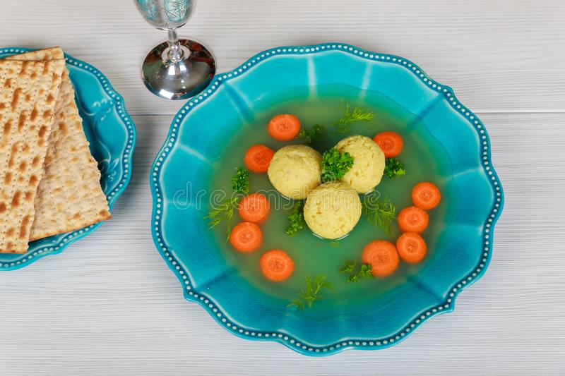 Matzah balls in a pot of soup during the Jewish holiday of Passover - Pesach. Traditional Jewish Matzah balls in a pot of soup during the Jewish holiday of royalty free stock images