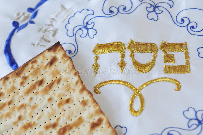 Traditional Jewish Matzo Sheets and Cover. Traditional Jewish Matzo sheets on a Passover Seder table. Passover is a Jewish holiday festival. It commemorates the stock photos