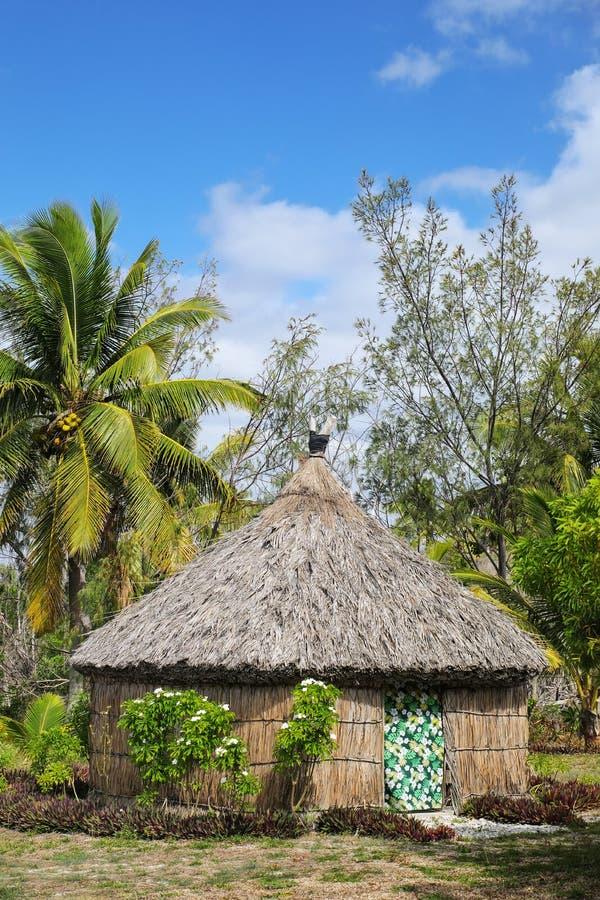 Traditional Kanak house on Ouvea Island,  Loyalty Islands, New Caledonia. Kanak are the indigenous Melanesian inhabitants of New Caledonia royalty free stock photo