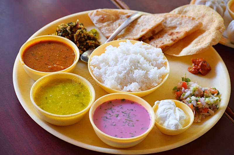 A Traditional Konkan Cuisine - a Complete Indian Meal. This is a photograph of a traditional Indian meal from Konkan region... The plate contains chapati, rice royalty free stock photo