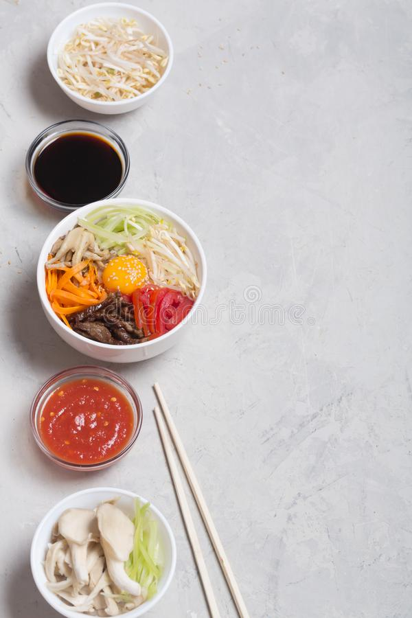 Traditional Korean Bibimbap dish with rice and vegetables on top stock photo