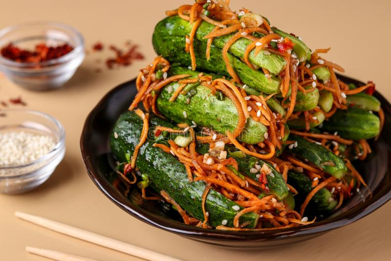 Traditional Korean cucumber kimchi snack: cucumbers stuffed with carrots, green onions, garlic and sesame, fermented royalty free stock photo
