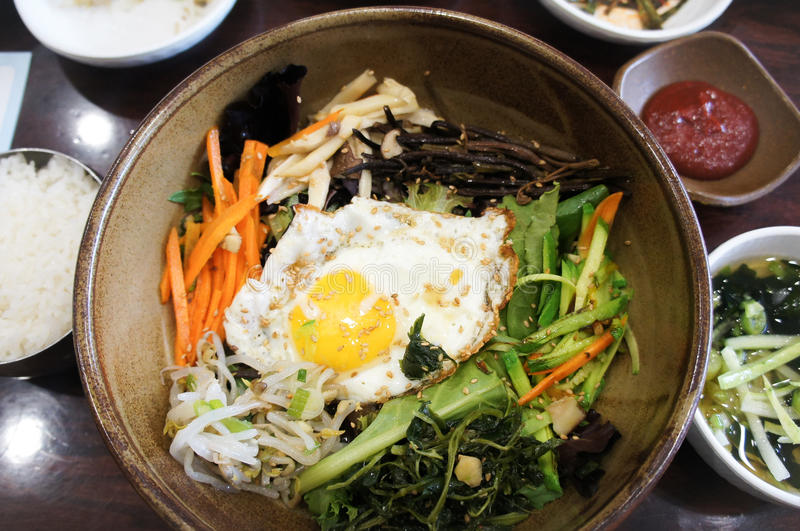 Traditional Korean dish bi bim bap with pickled and fresh vegetables and egg. royalty free stock photography
