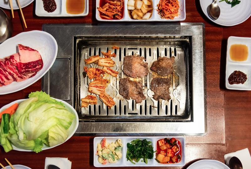 Traditional Korean meal with barbeque and vegetables stock photos