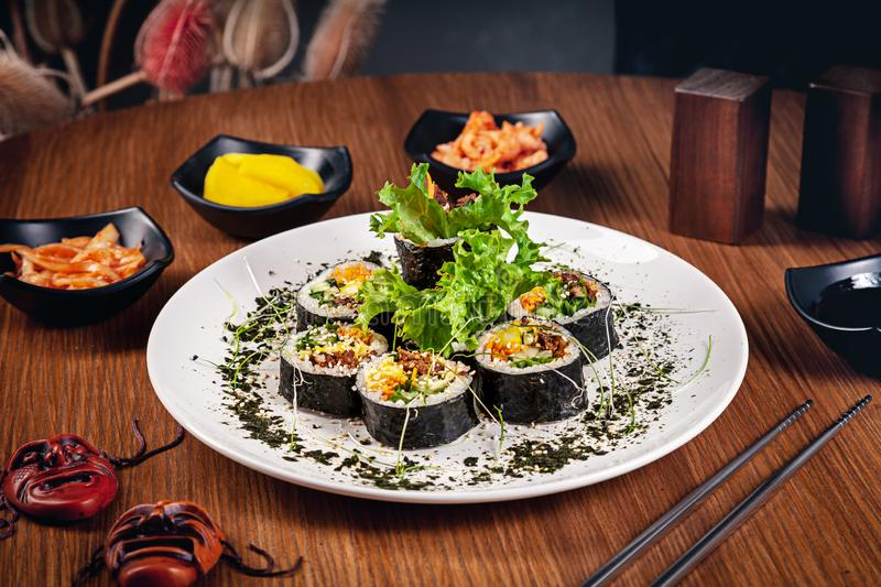 Traditional korean roll gimbap. Suchi roll with beef. Meat. Traditional korean cuisine set. Restaurant food background. Kimbap stock photos