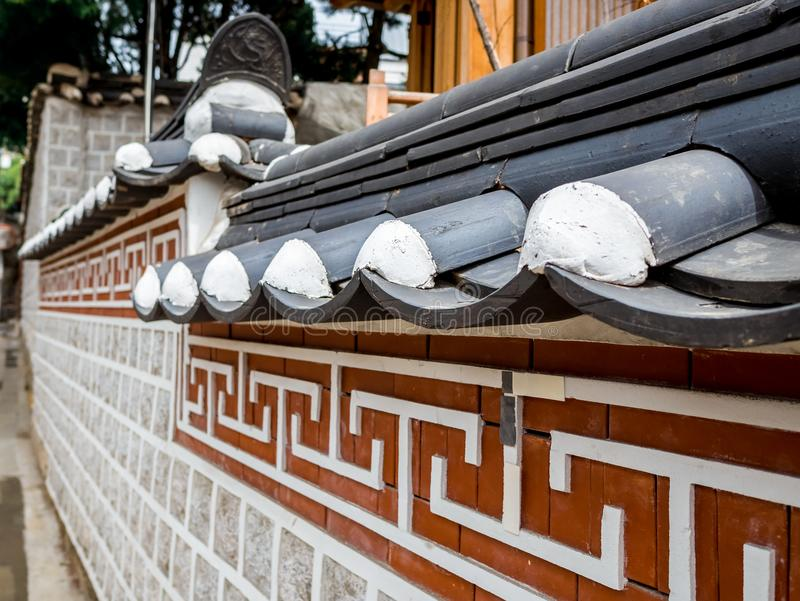 Traditional Korean wall style and historical house symbol architecture at Bukchon Hanok Village in Seoul, South Korea. Destination for tourist stock photo