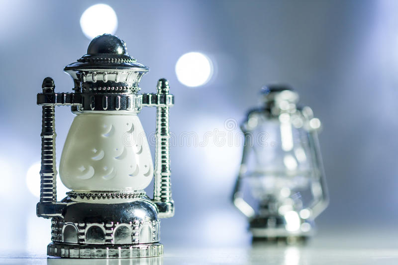 Traditional lamp. With out of focus lights as background stock images