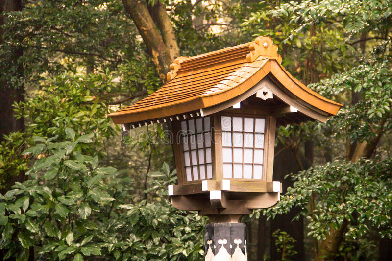 The traditional lantern in Meiji shrine Tokyo , Japan. stock photos