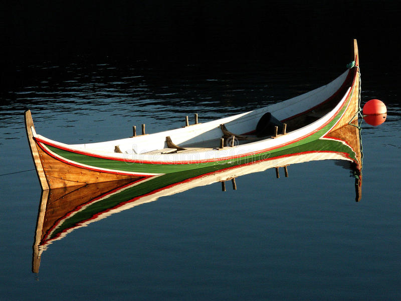 Traditional Lofoten's boat. Mirroring in a calm fjord of Moskenes island royalty free stock photos