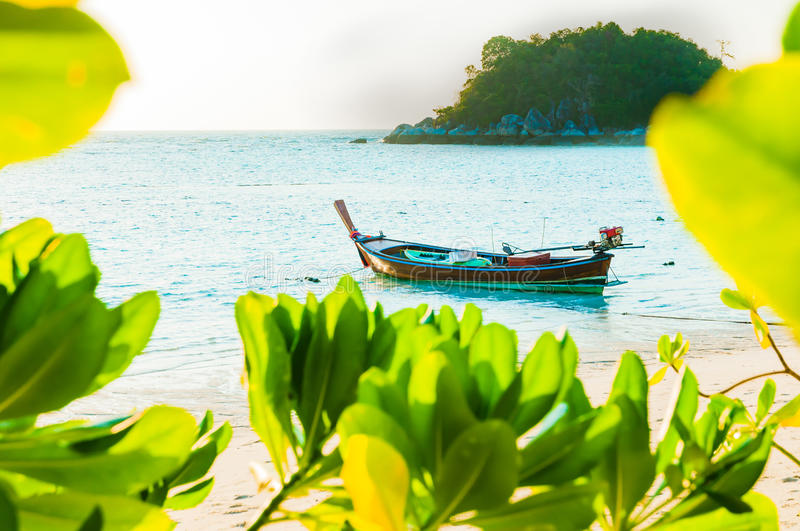 Traditional longtail boat docking in front of the beach in Lipe, Satun, Thailand; Selective focus. Traditional longtail boat docking in front of the beach in the royalty free stock images
