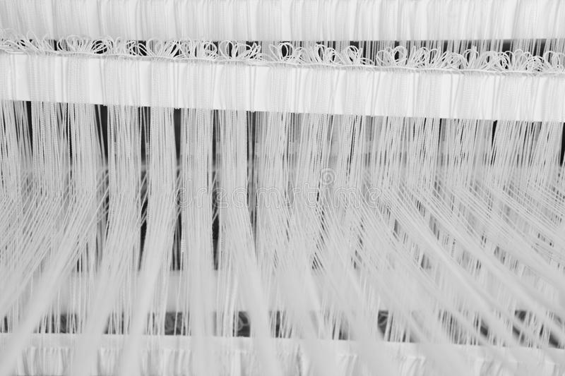 Traditional loom detail with wool yarn in black and white royalty free stock photos