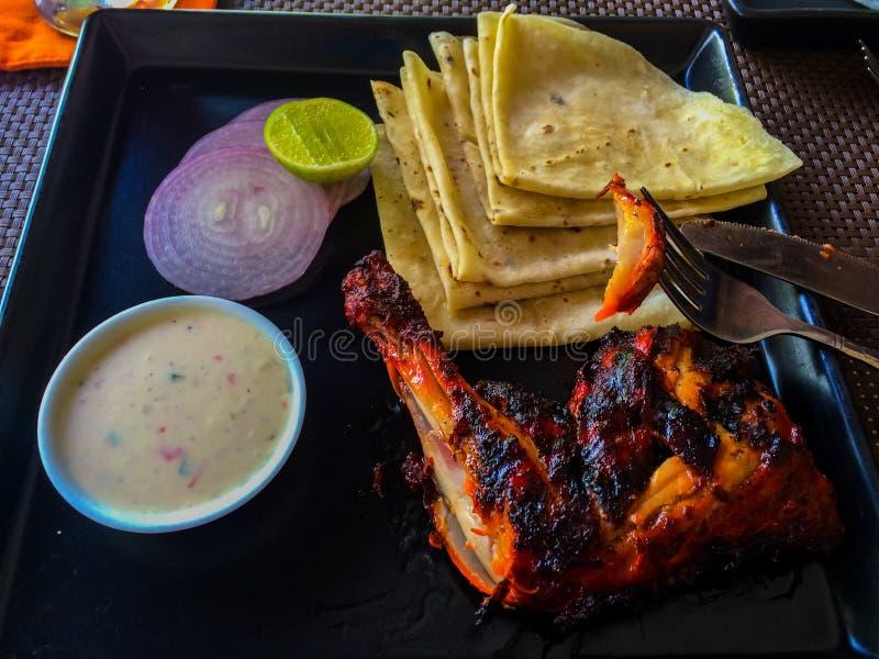 Traditional Maldivian Food. Tandoori fried chicken with traditional sauce, Maldivian soft crepes Riha-Folhi, onion and lemon royalty free stock photography