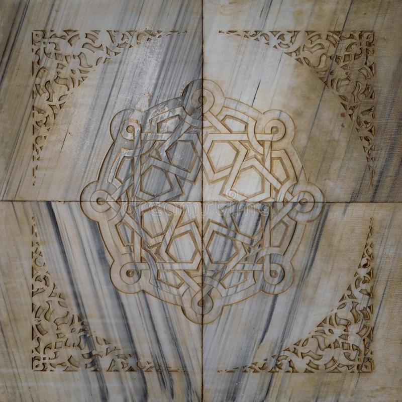 Mamluk era geometrical patterns carved into marble wall of mosque of Sultan Al Moaayad, Cairo, Egypt. Traditional Mamluk era round geometrical patterns framed by royalty free stock image
