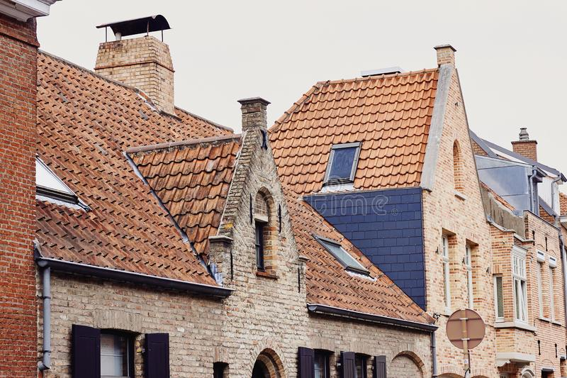 Traditional medieval architecture, brick houses with red tiled roofs royalty free stock photography