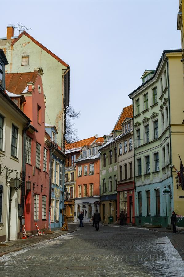 Traditional medieval houses in street of Riga old town. Winter and snow stock photos