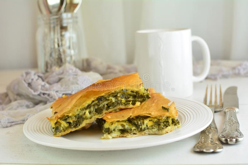 Homemade Traditional Mediterranean Spinach Pie with Cheese. A traditional Mediterranean pie made with spinach, cheese, eggs, and yufka royalty free stock photos