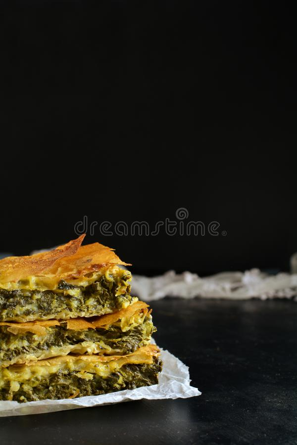 Homemade Traditional Mediterranean Spinach Pie with Cheese. A traditional Mediterranean pie made with spinach, cheese, eggs, and yufka royalty free stock photography