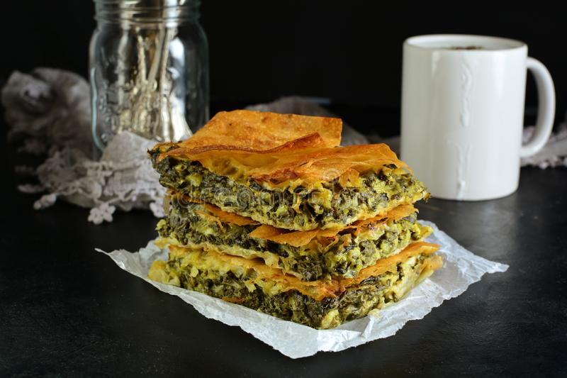 Homemade Traditional Mediterranean Spinach Pie with Cheese. A traditional Mediterranean pie made with spinach, cheese, eggs, and yufka stock image