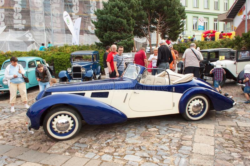 traditional meeting of fans of vintage cars and motorbikes. An exhibition of old cars in the town square of Tisnov royalty free stock images