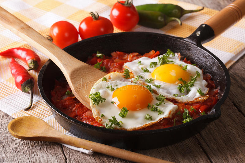 Traditional Mexican breakfast fried egg with salsa closeup. Horizontal stock photos